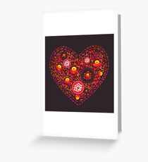 Valentine's Day card Heart made of red orange flowers on black background. Romantic invitation card.  Greeting Card