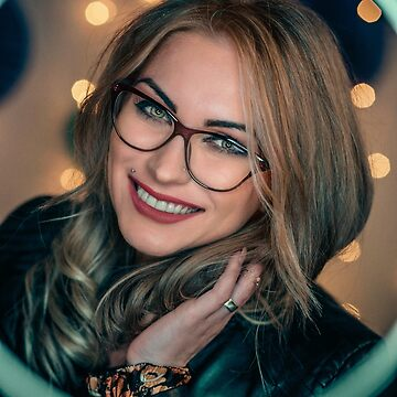 Beautiful young blonde woman with glasses by alexstreinu