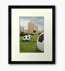 soccer balls on the cityscape Framed Print