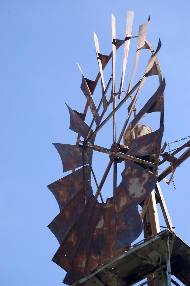 Blue sky, still windmill by Andrea Trotter