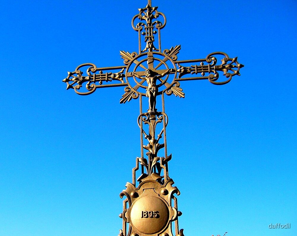 Old cross by daffodil