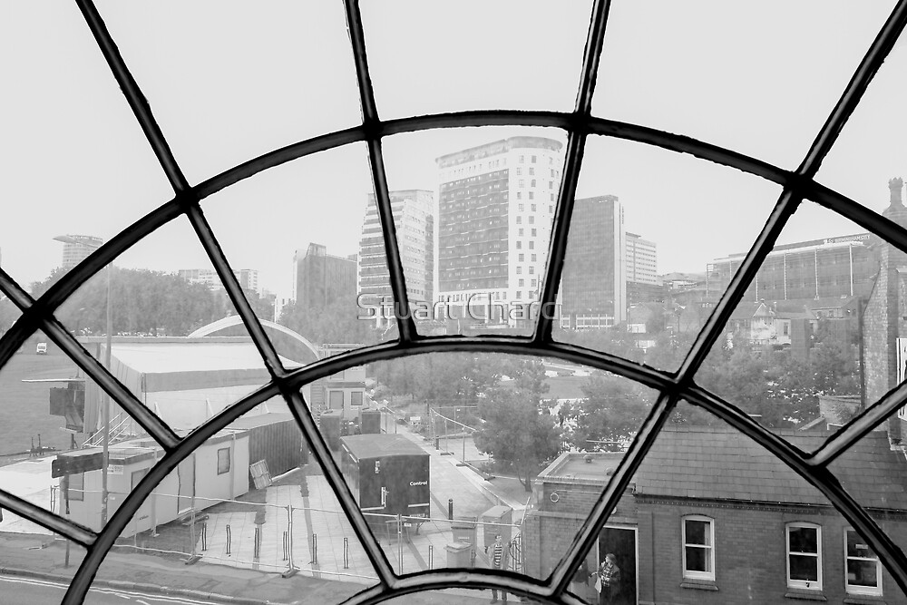 city view through arched window by stuartchard