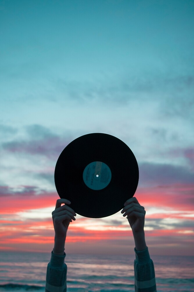 Hands holding record at sunset by FosilizdTreeSap