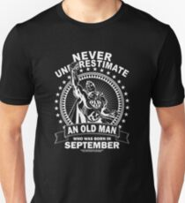 NEVER UNDERESTIMATE AN OLD MAN WHO WAS BORN IN SEPTEMBER Slim Fit T-Shirt
