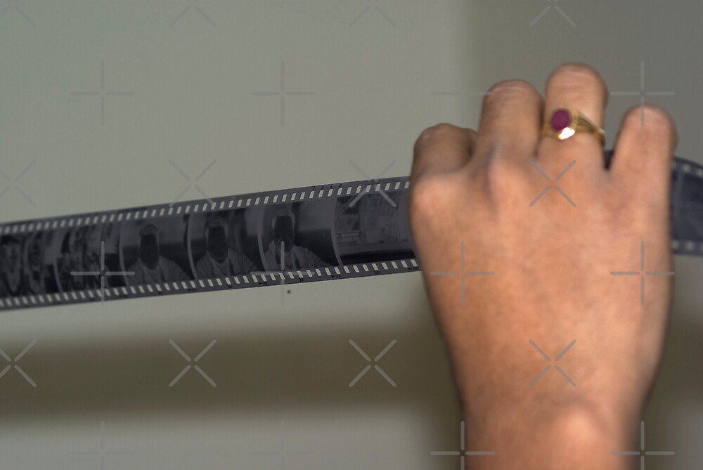 Person holding a strip of photo negatives by ashishagarwal74