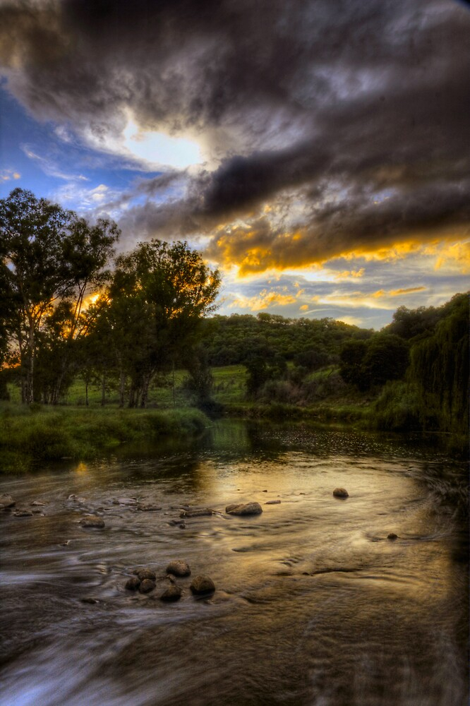 The river under a burning sky by Gideon van Zyl