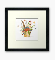 Basket with a bright bouquet of flowers. Framed Print