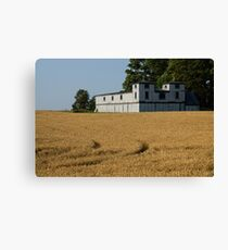 The Ancient Double Tower Barn in Golden Wheat Canvas Print