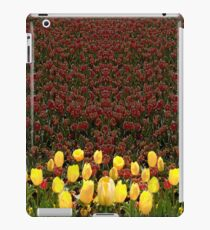 Yellow Tulip Flowers with contrast red tulip background iPad Case/Skin