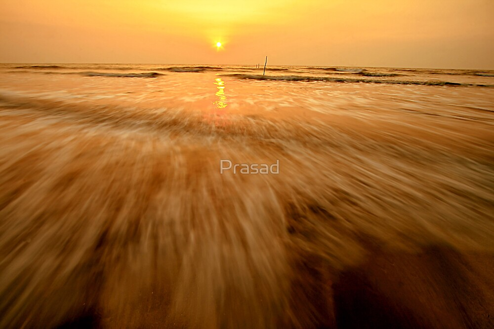 Sunset on the beach by Prasad