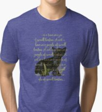 A cat is a lion in a jungle of small bushes Tri-blend T-Shirt
