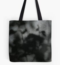 Leaves through a window Tote Bag