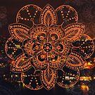 Orange mandala flower on tilt-shifted Gold Coast night lights photo by faithie