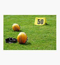 American football helmet and equipment on field Photographic Print