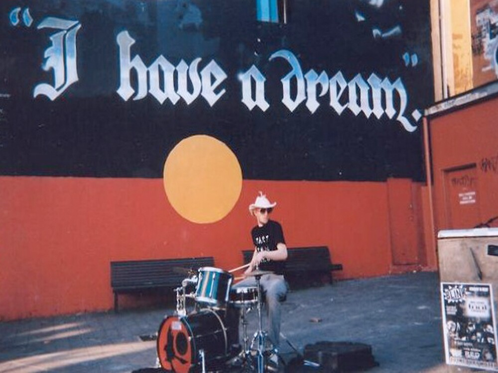 Newtown busker near mural by blaq produx