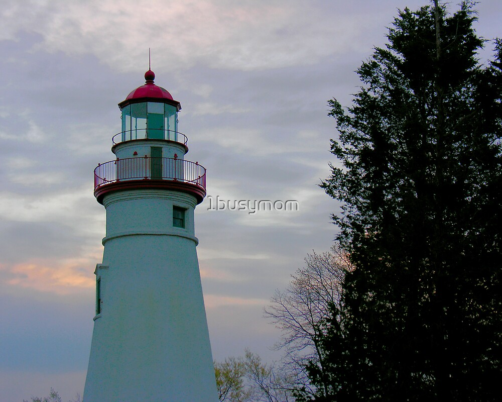 sunrise behind the lighthouse by 1busymom