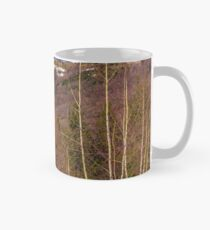 spring is coming to snowy mountain Mug