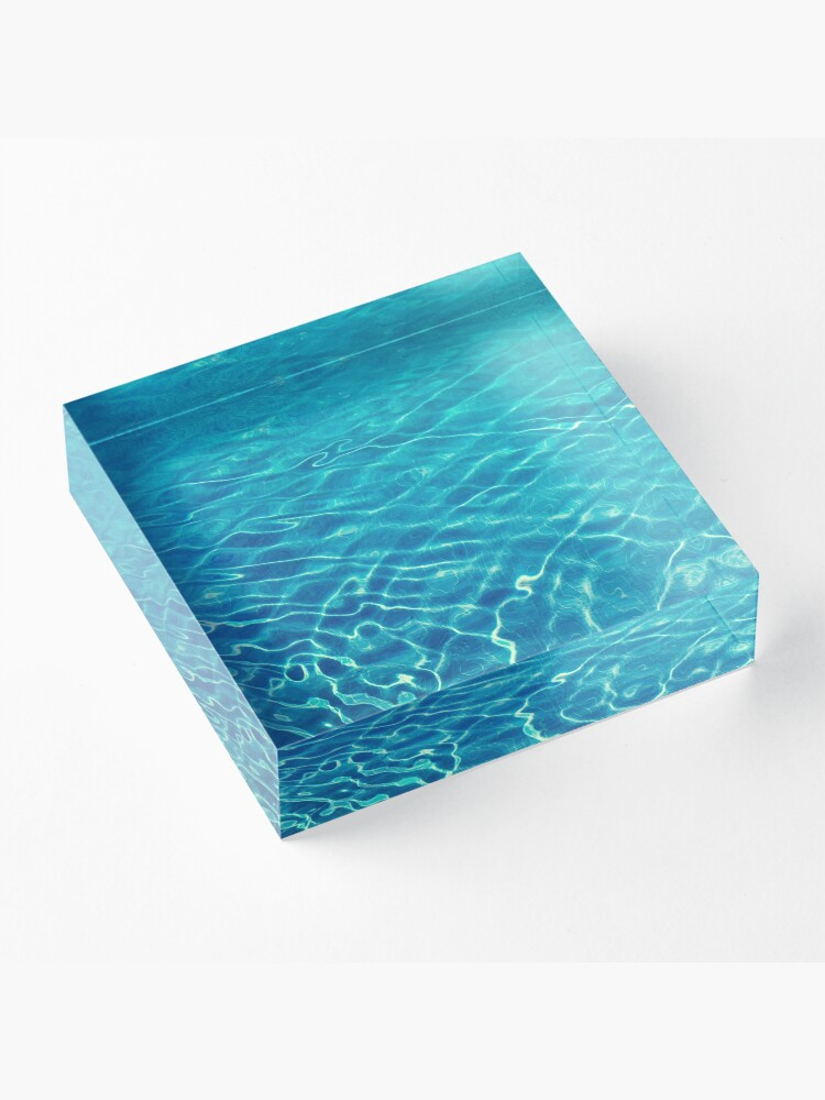 Alternate view of Ripples and wave patterns on crystal clear blue water Acrylic Block