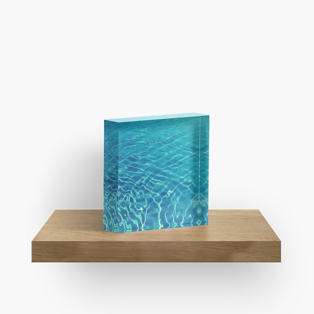 Ripples and wave patterns on crystal clear blue water Acrylic Block