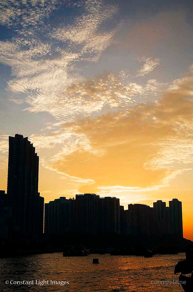 Sunset over Hong Kong skyline. by connieelaine