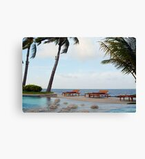 Lounge chairs at the swimming pool in Maldives Canvas Print