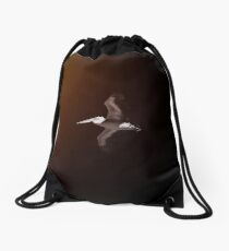 Beautiful pelican flying in the sky Drawstring Bag