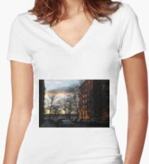 Evening, sunset, evening glow, the rays of the setting sun in the Windows, pink clouds Fitted V-Neck T-Shirt
