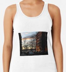 Evening, sunset, evening glow, the rays of the setting sun in the Windows, pink clouds Racerback Tank Top