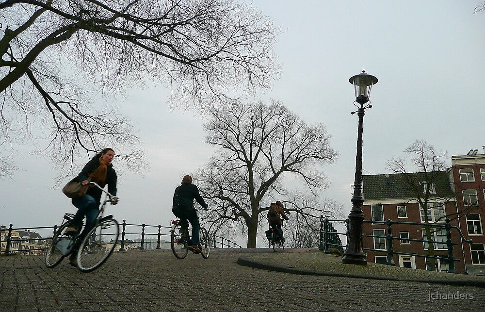 Cyclists crossing a bridge at Amsterdam by jchanders
