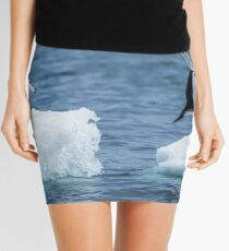 Adelie penguin jumping between two ice floes Mini Skirt
