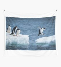 Adelie penguin jumping between two ice floes Wall Tapestry