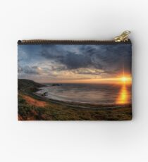 Sunset over Clonque Bay on Alderney Zipper Pouch