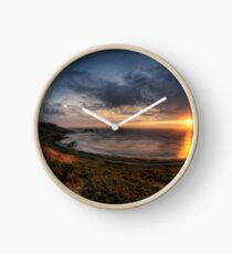Sunset over Clonque Bay on Alderney Clock