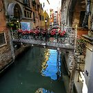 Venetian Bridge with flowerpots by hans p olsen