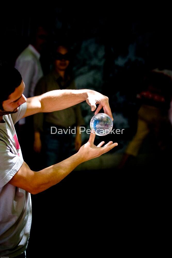 Man and his magic balls 2 by David Petranker