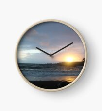 Sunrise on a Black Beach Clock