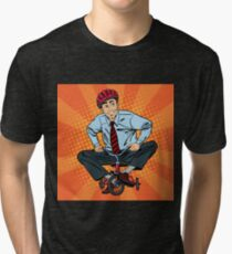 Businessman on Children Bicycle. Businessman Riding a Small Bicycle. Fun at Work. Pop Art.  Tri-blend T-Shirt