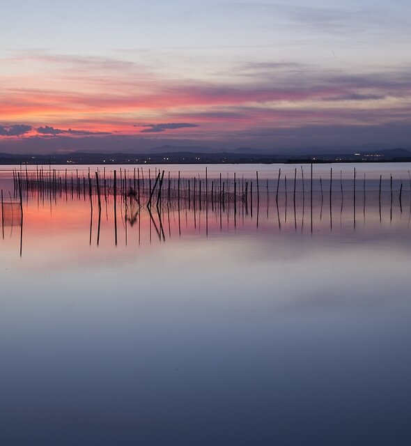 Peaceful view of the Valencia water's surface with the land in the distance by PRODUCTPICS