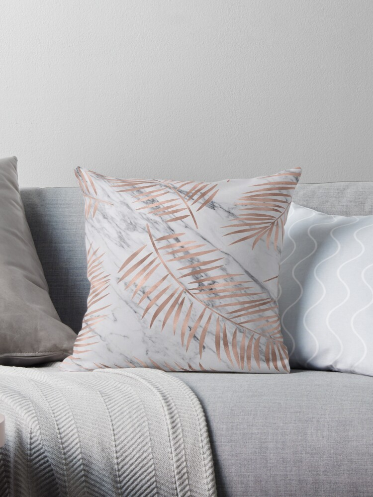 Rose gold palm fronds on marble by marbleco