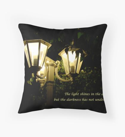 the light shines in the darkness Throw Pillow