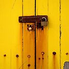 Rusty latch on beach box by VisualFX