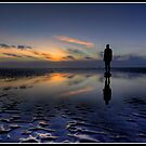 Sunset over the statues at Crosby by Shaun Whiteman