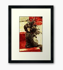 Modest girl and attracting plant Framed Print
