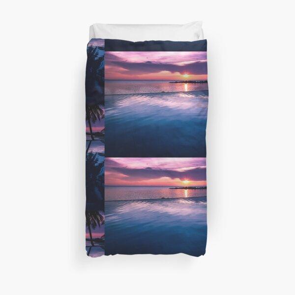 Tropical sunset pool Duvet Cover