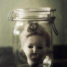 doll in jar by Joana Kruse