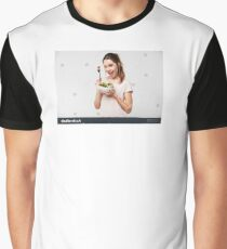 Portrait of a happy playful girl eating fresh salad from a bowl and winking isolated over white background Graphic T-Shirt