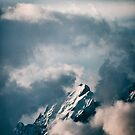Majestic Snow-Covered Alpine Peaks on Cold Blue Winter Day by visualspectrum