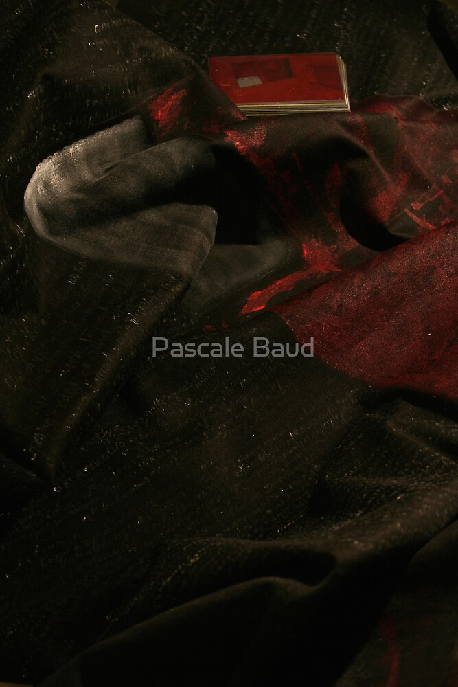 Open red in dark by Pascale Baud