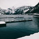 Norwegian Fjord and Surrounding Moutains on Cold Winter Day by visualspectrum