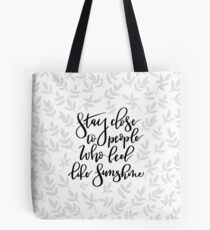Stay close to people who feel like sunshine quote Tote Bag
